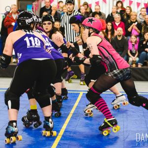 The Pink Pistols' I'llah Smashya jams against CarnEvil on March 14, 2015 at Shoreline Derby Center.